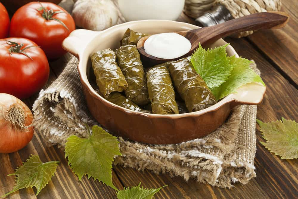 Greece - Athens - Dolma from grape leaves and minced on the wooden table Greek Food