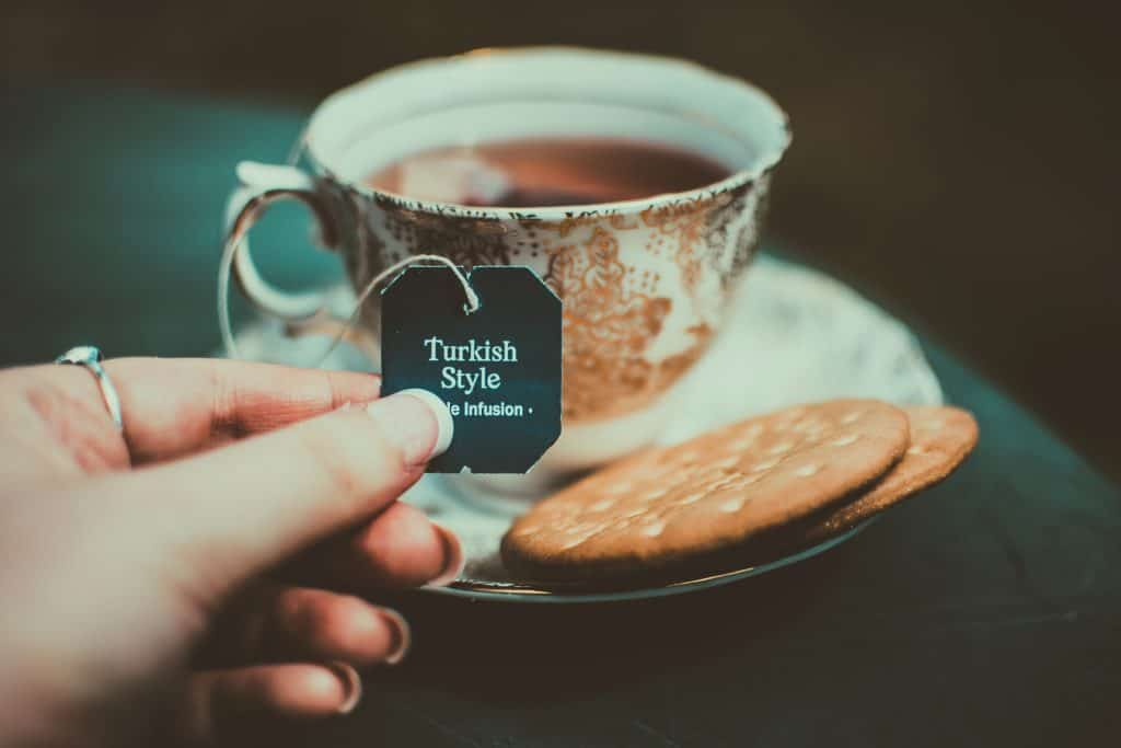 Canva - Person Holding Turkish Style Tea Bag Tie