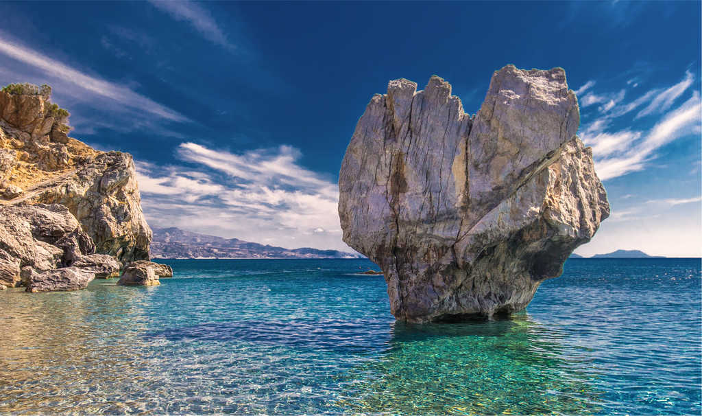 Prevelli Beach, Crete, Greece - Image of blue water with rock that looks like mermaid tail