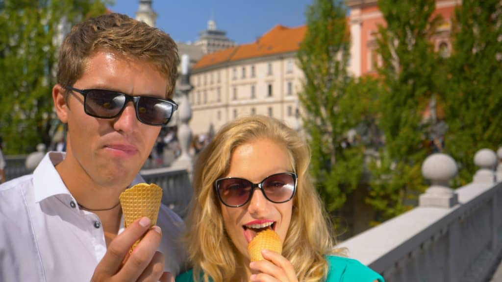 Slovenia - Ljubljana - Man and woman eating ice cream