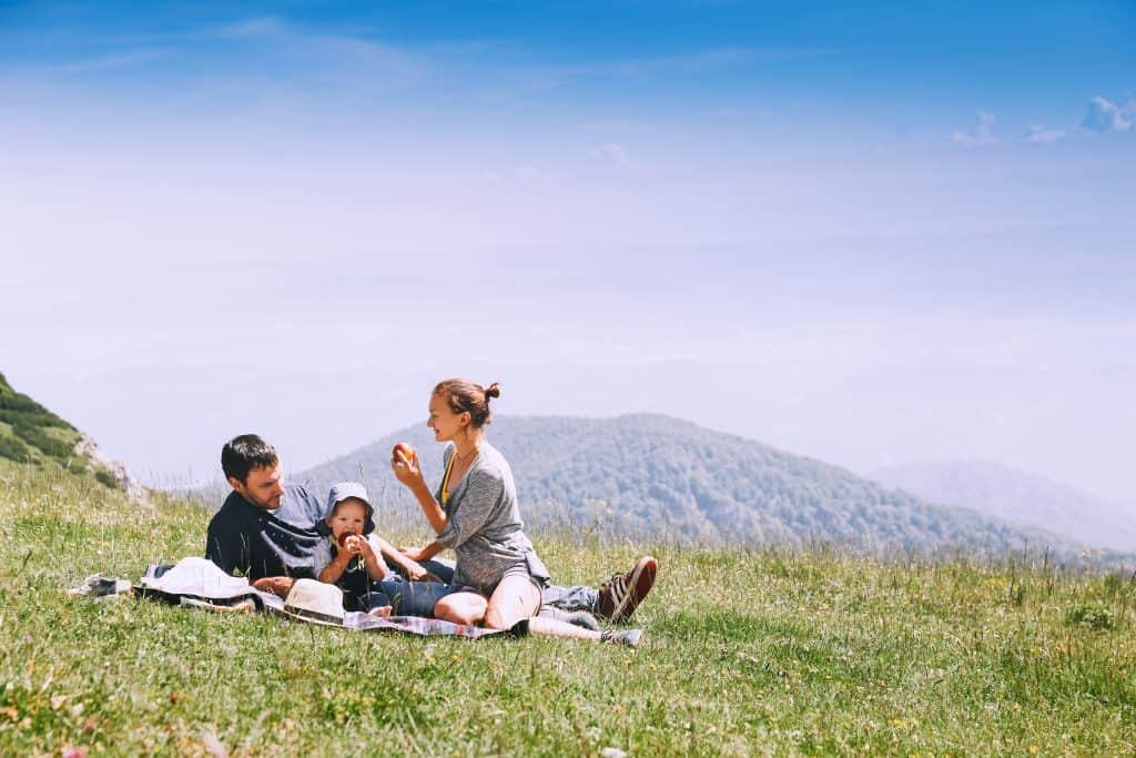 Slovenia - Velika Planina or Big Pasture Plateau in Kamnik Alps - Family Man Woman Baby