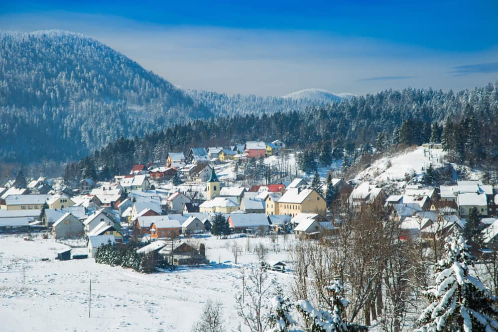 Town of Lokve, Gorski Kotar region of Croatia - houses covered in snow from mountain.