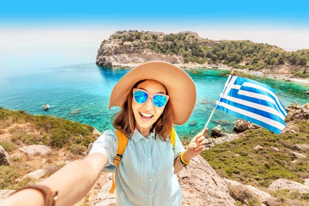 Greece - Crete - Woman with Greece Flag