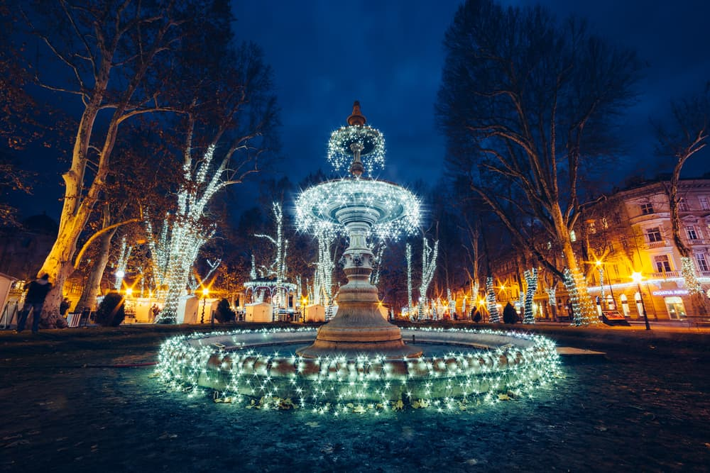 Zagreb Christmas Market - Fountain lit up at night in Croatia in winter