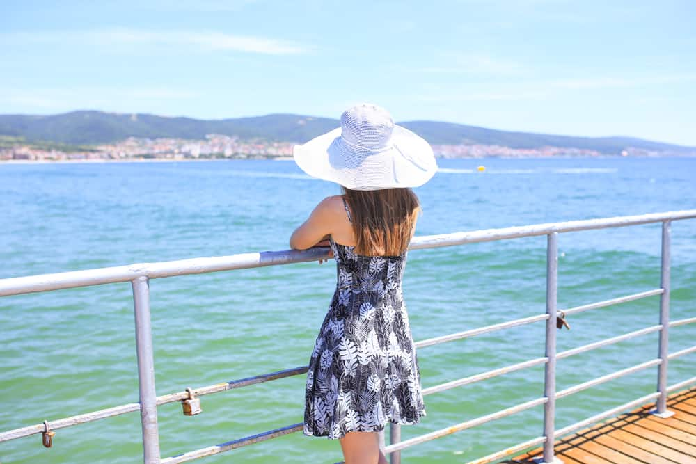 Bulgarian - Sunny Beach - Lady in hat on the pier of Sunny Beach