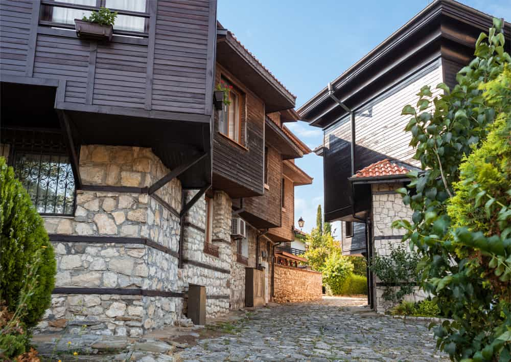 Bulgaria - Nessebar - Typical residential architecture and narrow cobblestone street in the old town of Nessebar, Bulgaria