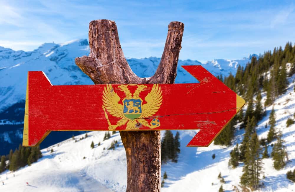 Kolasin - Montenegro - Snow with Montenegro flag sign