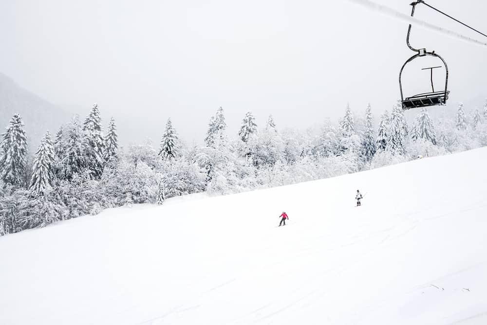 Kolasin - Montenegro - Skiers and chair lift