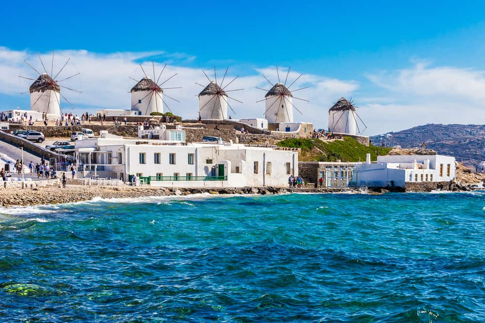Mykonos - Greece - Beach with turquoise water and three white windmills