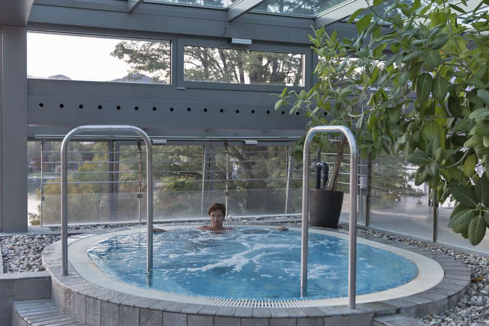 Bled - Slovenia - Woman relaxing in luxury hot tub