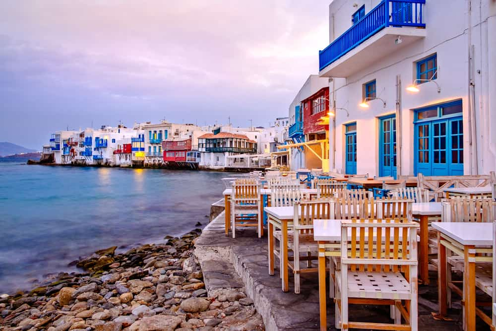 Mykonos - Greece - Sunset in Little venice with colorful chairs and buildings