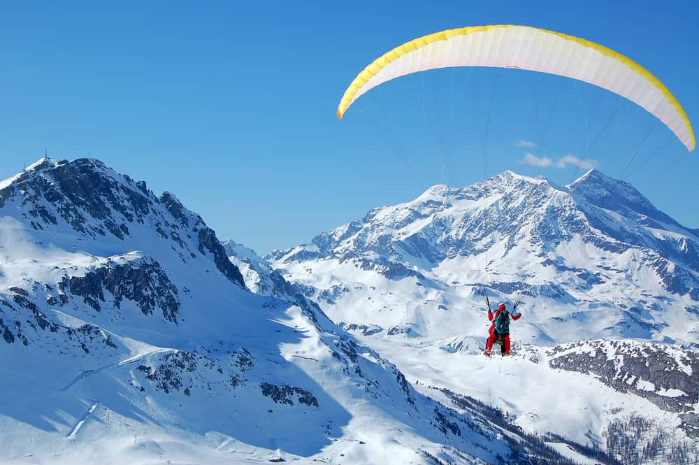 Paragliders flying in the mountains