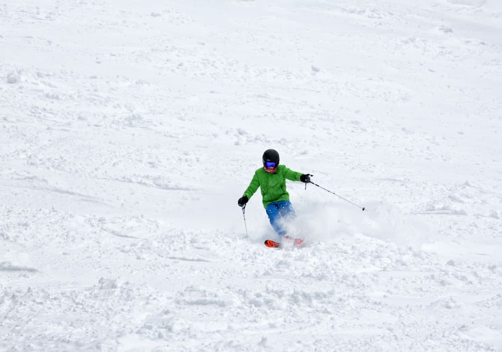 Bulgaria - Borovets - Ski slope, young boy skiing down the hill. Free ride.Alpine ski resort Borovets, Rila mountain, Bulgaria