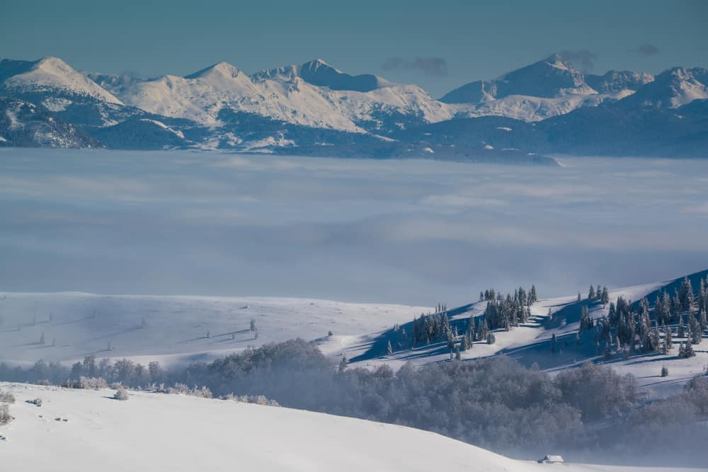 Kolasin - Montenegro - Snow covered mountains with clouds in Montenegro