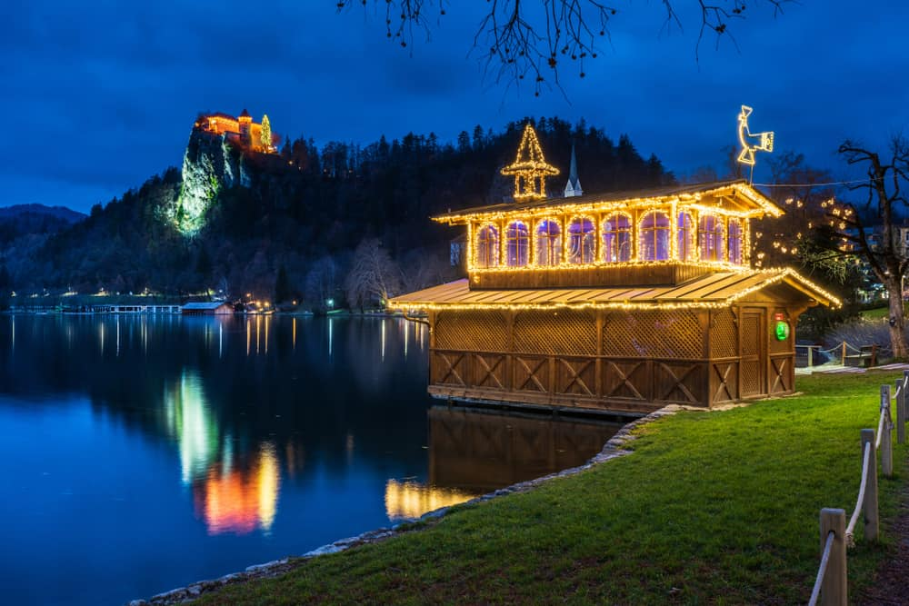 Slovenia - Lake Bled - By Nicola Simeoni Royalty-free stock photo ID: 1293495943 Night on Lake Bled. Christmas atmosphere and lights. Castle and Church of the Annunciation