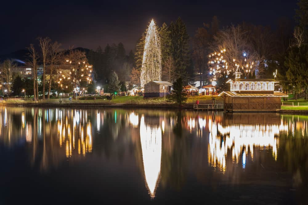 Slovenia - Lake Bled - Night on Lake Bled. Christmas atmosphere and lights. Castle and Church of the Annunciation - Image