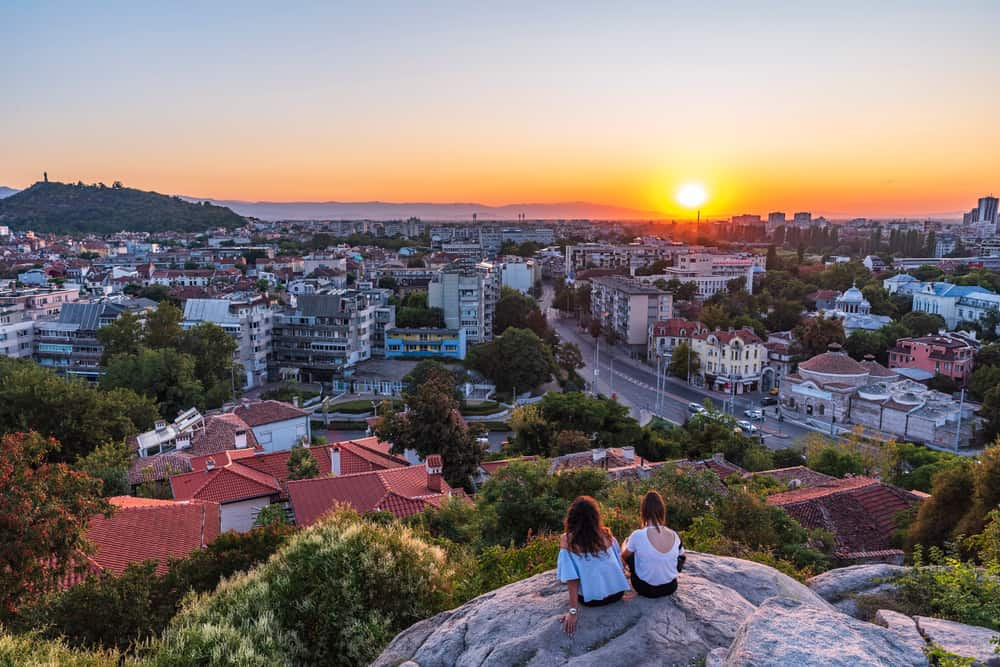 Bulgaria - Plovdiv - Girls watching sunset from Nebet tepe Hill in Plovdiv city, Bulgaria. Panoramic view from the oldest european city. Ancient city is UNESCO's World Heritage. - Image