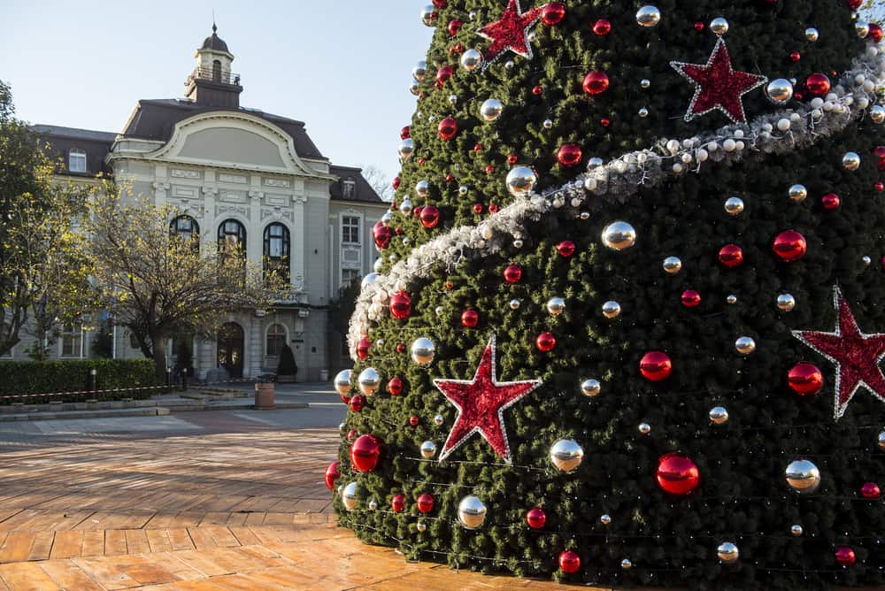 Bulgaria - Plovdiv The Christmas tree with the city hall at the background at the center of the city of Plovdiv in Bulgaria