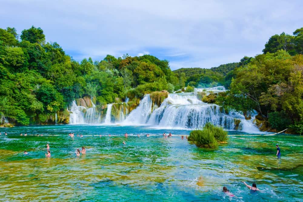 People swimming in waterfalls at Krka