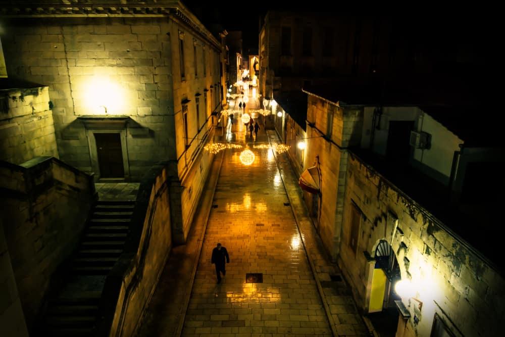 Croatia - Zadar - Silhouttes walking along the chrismas decorated cobbled streets of Zadar at night, Croatia, Europe