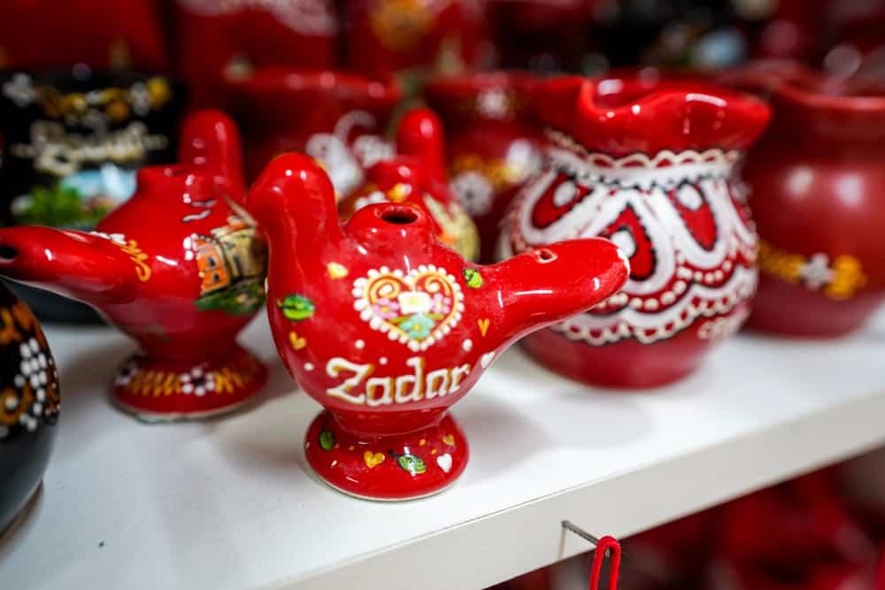 Croatia - Zadar - Mini red pot in ceramic texture in suveinor shop of Zadar, Croatia
