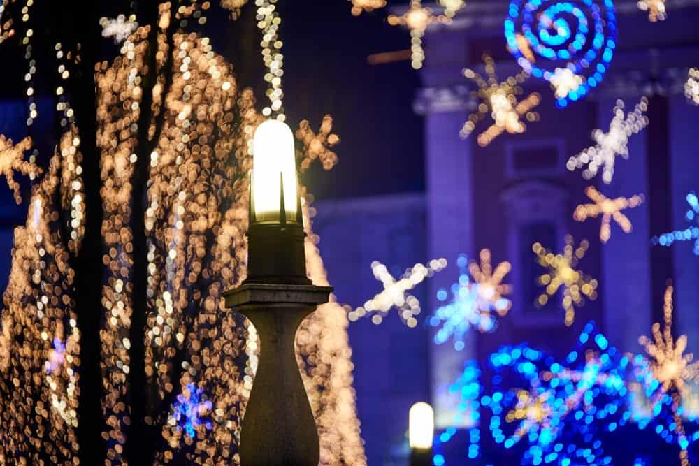 Slovenia - Ljubljana - Advent December night with Christmas decoration lighting in Ljubljana's city center at dusk.