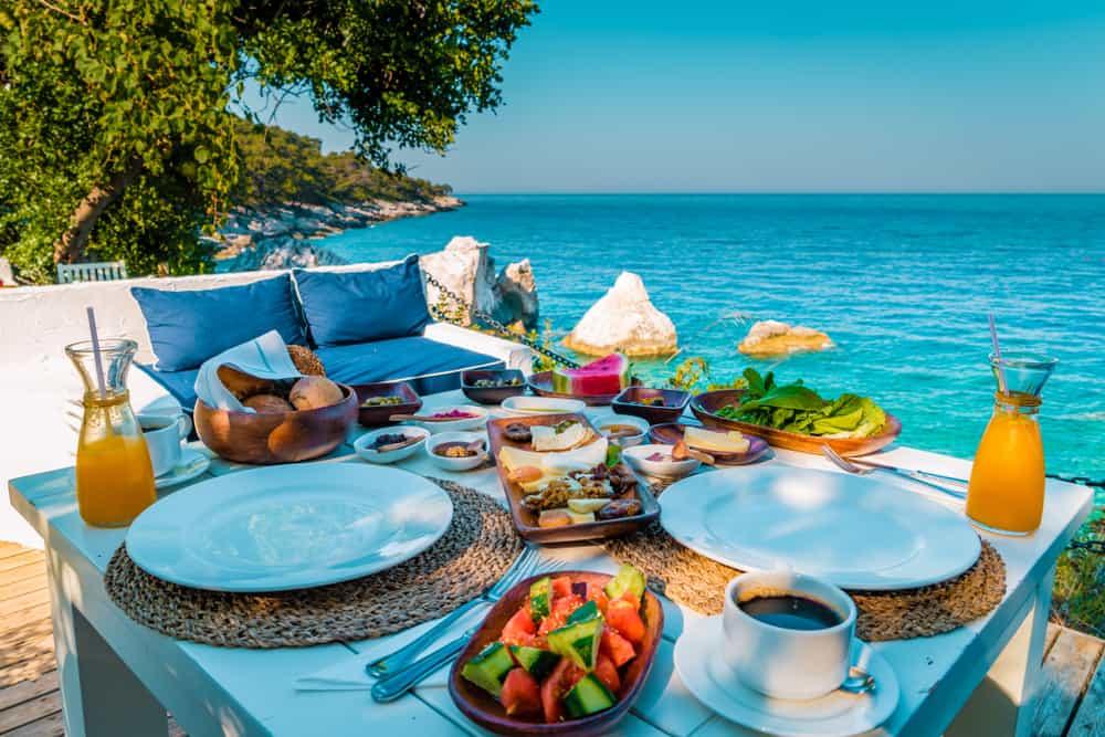 A beautiful breakfast spread overlooking a turquoise sea in Faralya
