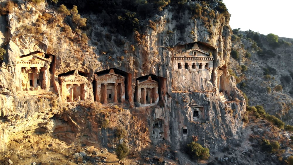 Temples carved into rock on cliff