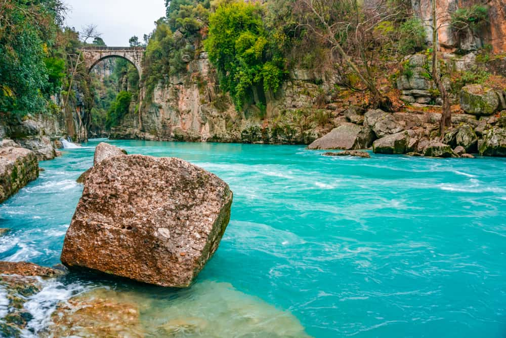 "Turkey - Antalya - The old bridge is known as ""Bugrum or Oluk"" bridge. Koprucay river landscape from Koprulu Canyon National Park in Manavgat, Antalya, Turkey. The Ancient Roman architecture."
