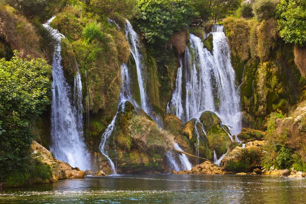 Herzegovinian Oasis in the Stone: How to Visit the Stunning Kravica Waterfall