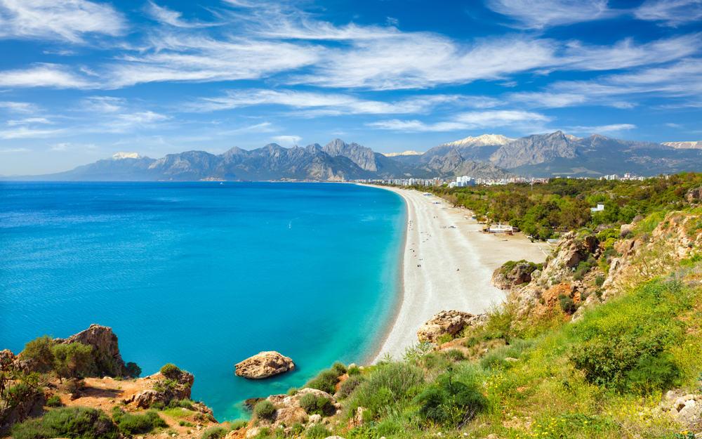 Turkey - Antalya - Aerial view of beautiful blue gulf and long Konyaalti beach in Antalya, Turkey. Antalya is Turkey's biggest international sea resort located on Turkish Riviera.