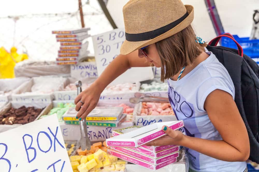 Woman picking out Turkish delight in market