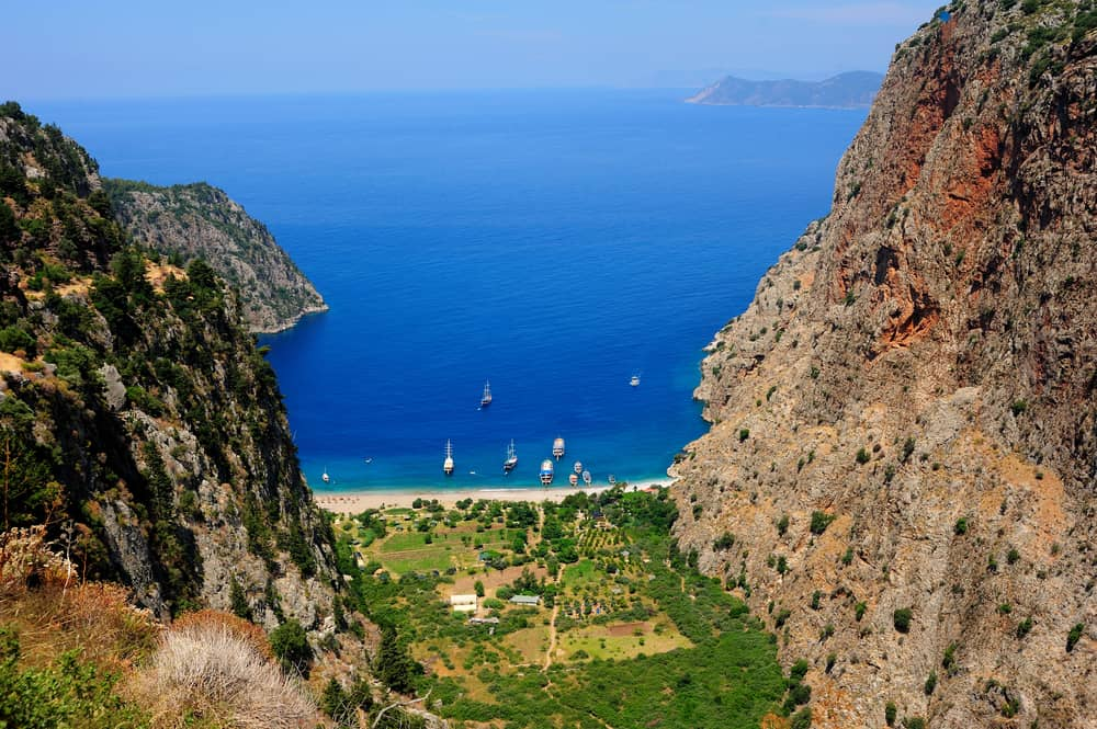 Beautiful isolated beach between two cliffs and a valley