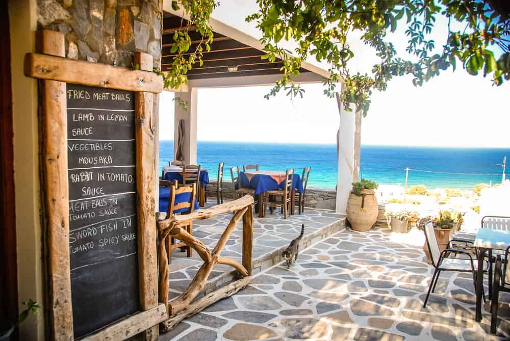 Taverna with daily menu on beach front with cat on patio