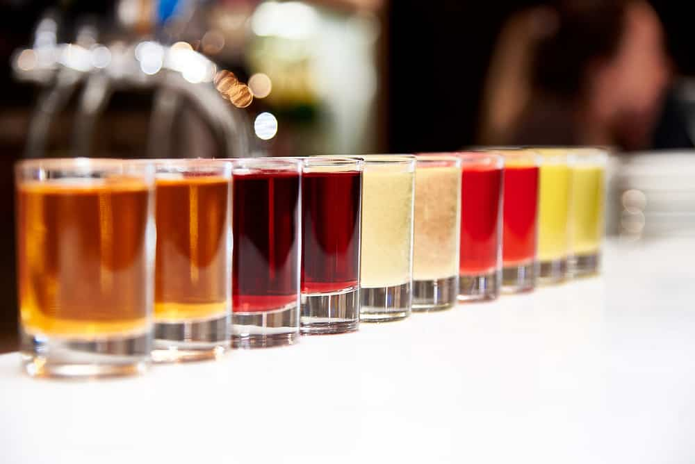 Multicolored alcoholic shots on the bar counter
