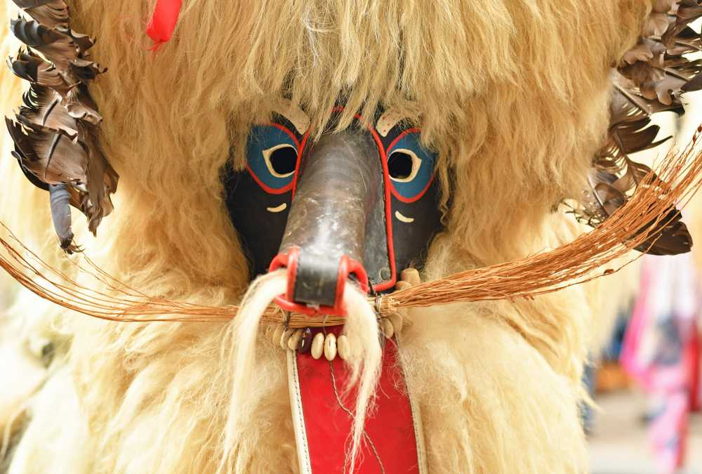 Slovenia - Traditional carnival on shrove Saturday with traditional figures, known as kurent or korent and close-up of a mask in Ljubljana, Slovenia