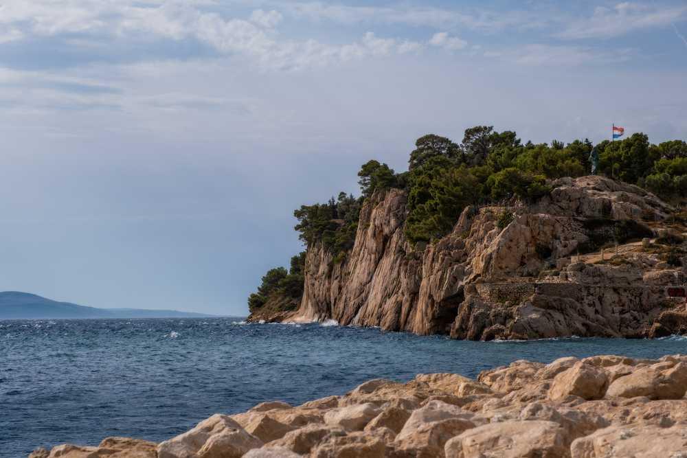 Croatia - Makarska - MAKARSKA RIVIERA, CROATIA - August 2020: View of the rocks near Makarska on a summer day, in Makarska Riviera, Croatia.