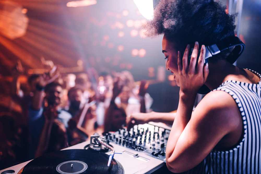 Greece - Crete - Shot of a female DJ playing music in the club
