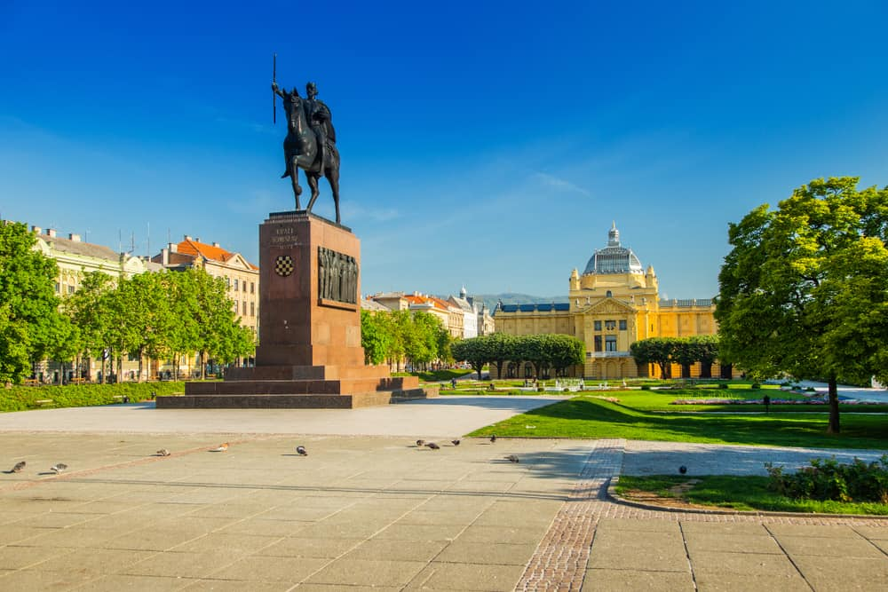 A man on a horse statue in front of the same yellow Art Pavilion building from earlier in the post