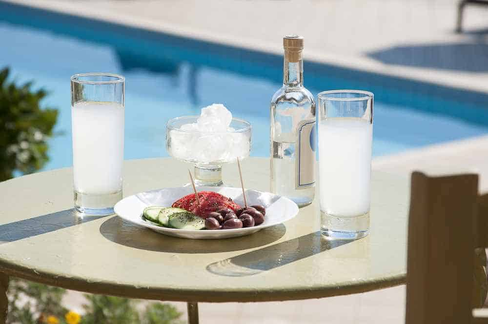 Greece - Mykonos - Ouzo and appetizer in front of swimming pool.