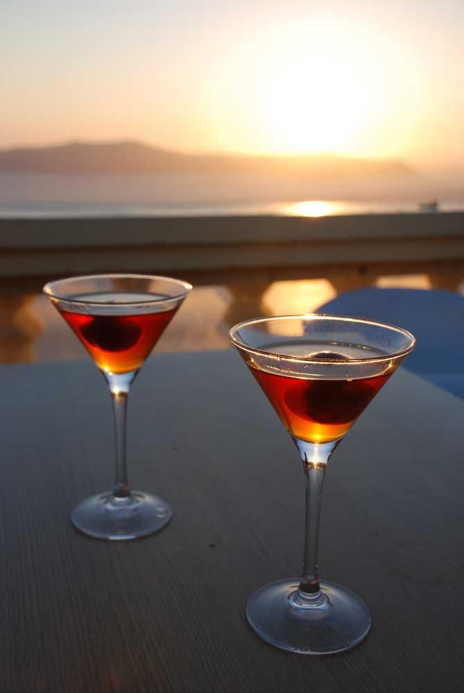 Greece - Santorini - Vinsanto wine at the Sunset in Oia, Santorini, Greece.