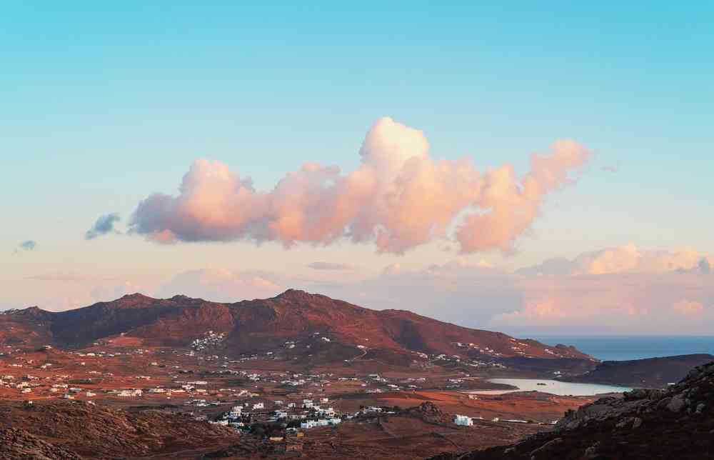 Greece - mykonos - Mykonos island (view from the mountain) at sunrise with clouds in the sky. Greece.