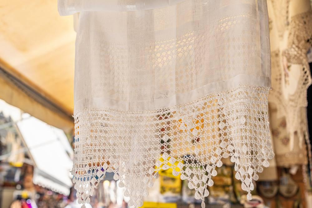 Greece - Crete - Embroidered traditional tablecloth at the tourist souvenir market of Crete, Greece