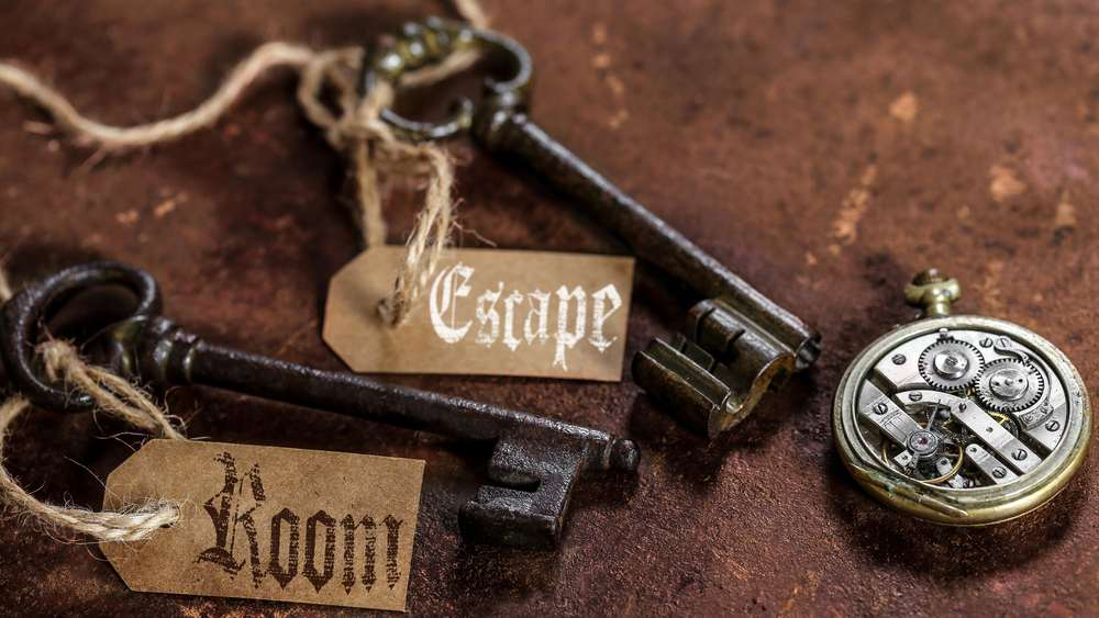 Romania - Timisoara - two old keys on a rusty metal table with labels : escape room