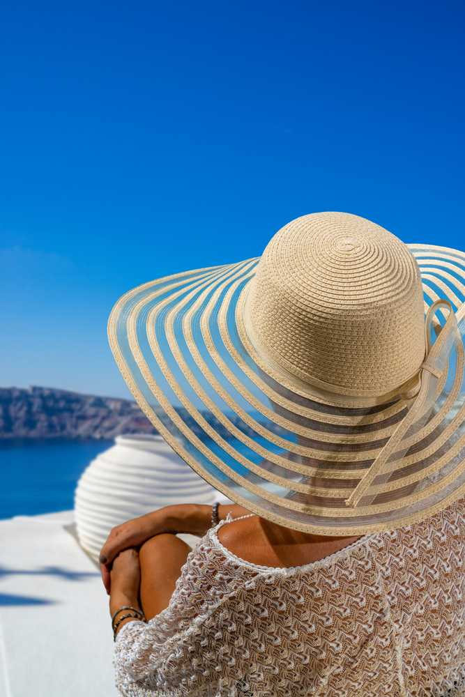 Greece - Santorini - Woman on holidays in Santorini island in Greece