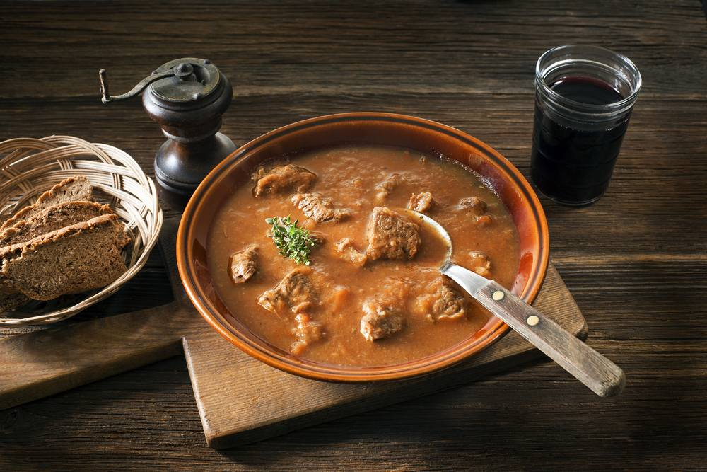 Slovenia, Maribor - Portion of traditional Beef stew - goulash on wooden table