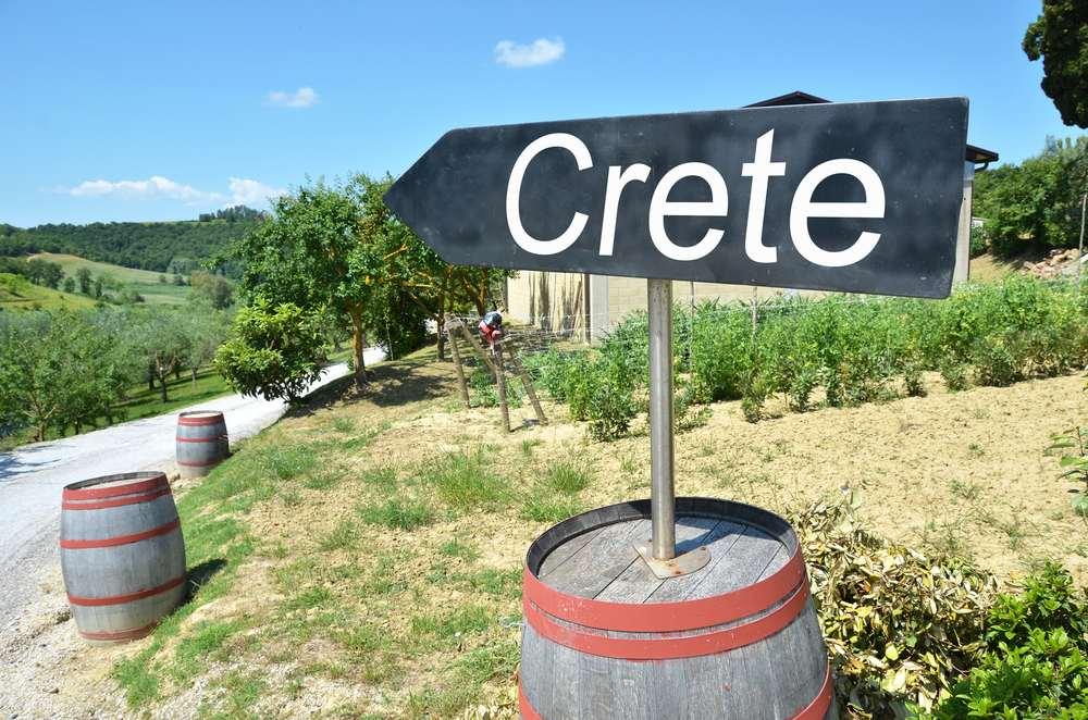 Greece  - Crete  -CRETE arrow and wine barrels along rural road