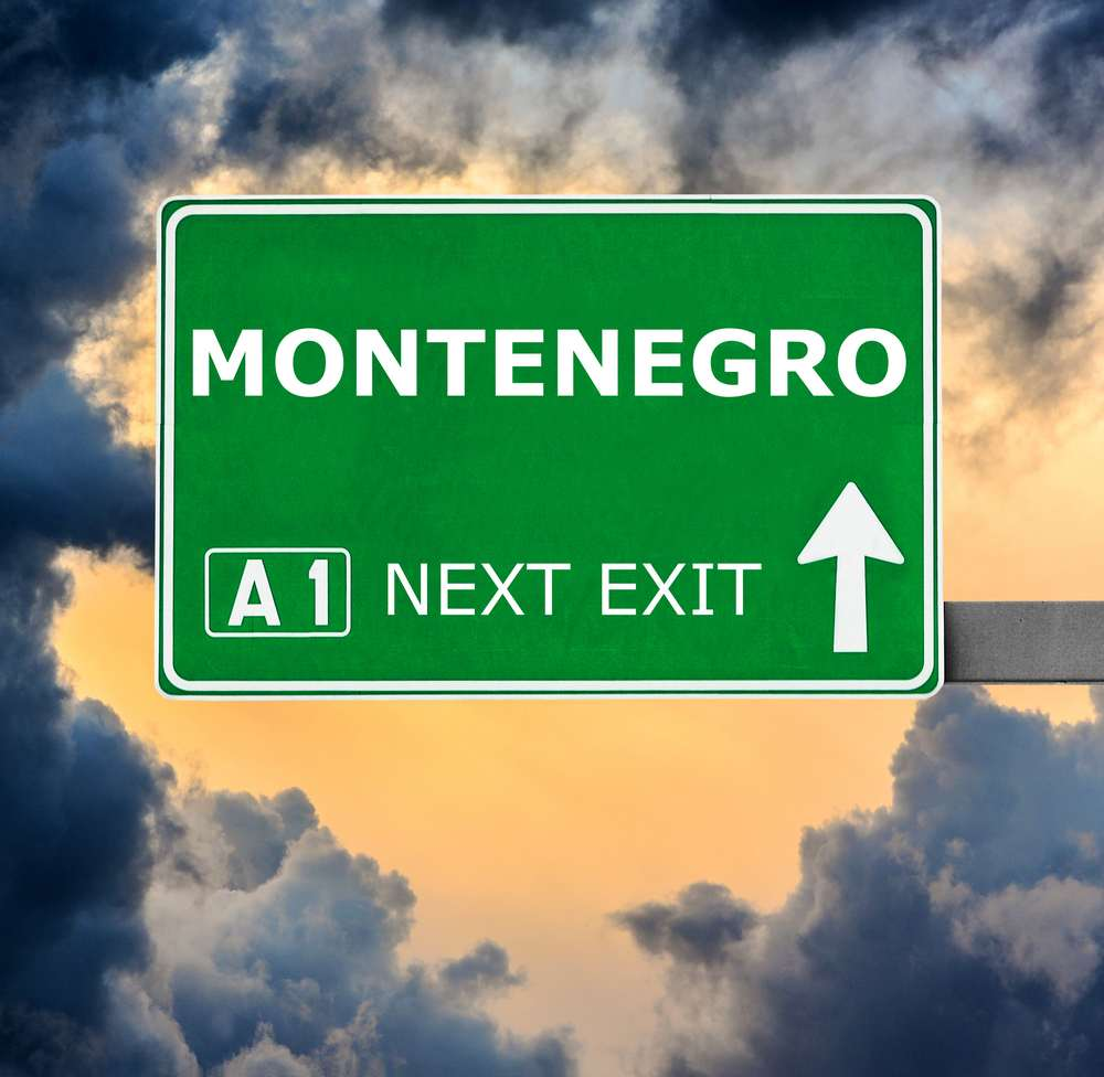 Montenegro - MONTENEGRO road sign against clear blue sky