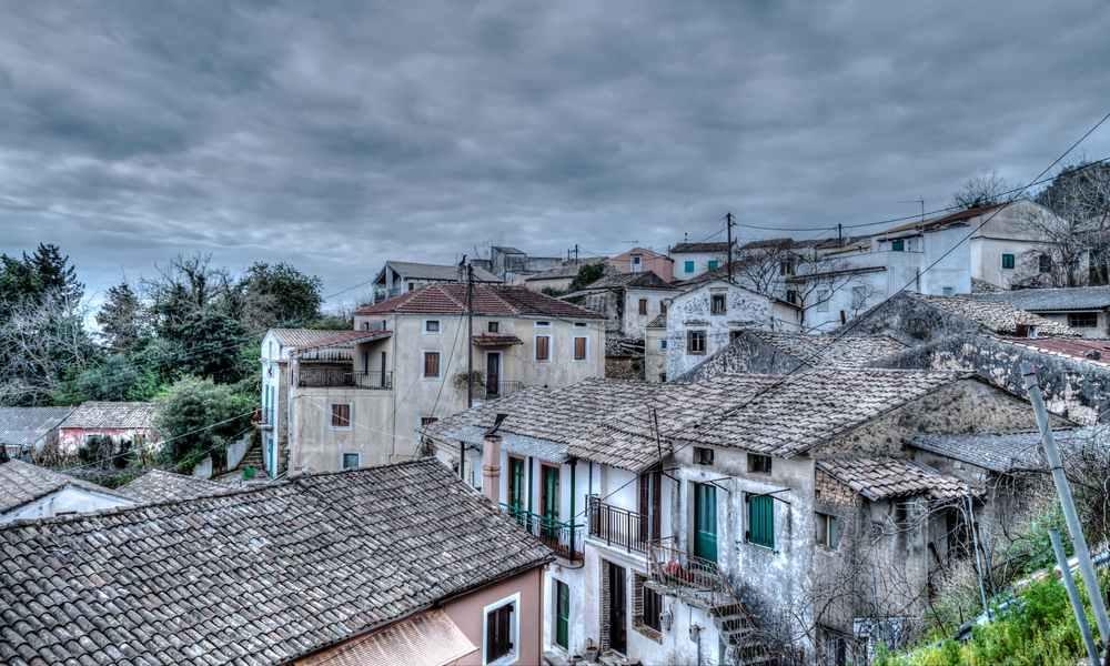 Greece - Corfu - Chlomos village in South Corfu Greece with dramatic sky and color.