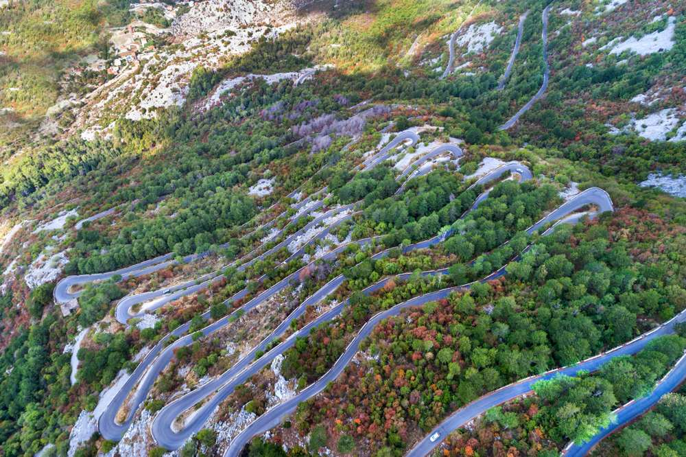 Montenegro - Aerial view on the Old Road serpentine in the national park Lovcen, Montenegro.